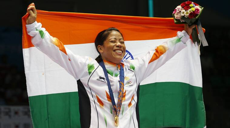 India's M.C. Mary Kom holds the Indian national flag and celebrates her gold medal in the women's flyweight (48-51kg) final boxing match (Source: AP)