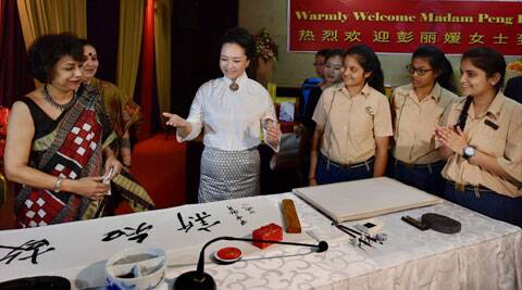 With calligraphy and grace, First Lady woos students