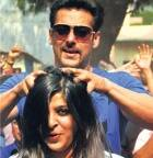 Salman Khan to turn barber, Karan Johar a lensman for 'Mission Sapne'