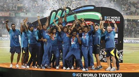 Sri Lanka's players and team officials pose for a group photo while celebrating with the trophy after winning the ICC World Twenty20 (AP)