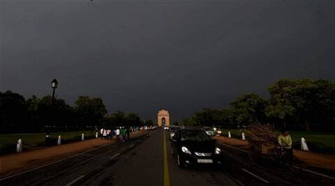 A view of Rajpath as it gets dark due to a storm accompanied by dark clouds in New Delhi on Friday. (Source: AP)