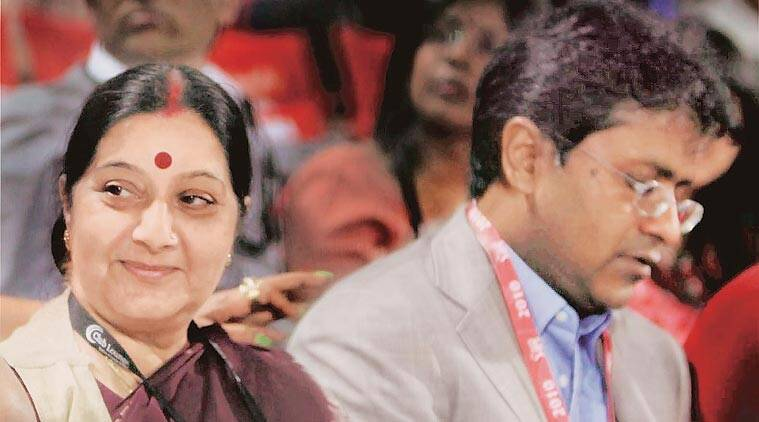 Modi with Sushma during an IPL match in 2010. (Source: Express Archives)