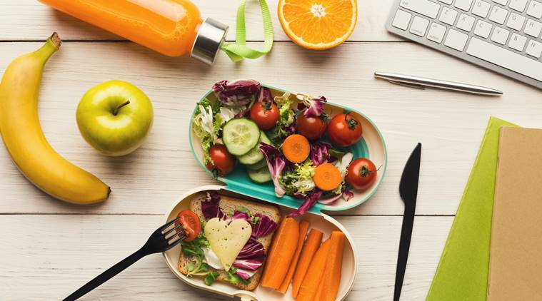 Healthy habits for working professionals, work stress, indianexpress.com, diet for working professionals, indianexpressonline, indianexpress, have breakfast, sipping water through the day, how to feel energetic in office, snacks as fruits, desk diner, caffeine, office hours, long office hours and diet, how to avoid energy loss in office, what to eat to keep energy high, overworking,