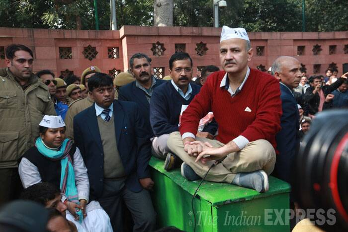 In an unprecedented action, Delhi Chief Minister Arvind Kejriwal and his ministers today began a dharna outside Rail Bhavan demanding action against police officials who refused to carry out a raid on an alleged drug and prostitution racket in South Delhi last week. <br /> Delhi Chief Minister Arvind Kejriwal during his protest outside Rail Bhavan with Manish Sisodia on Monday in New Delhi. (IE Photo: Renuka Puri)