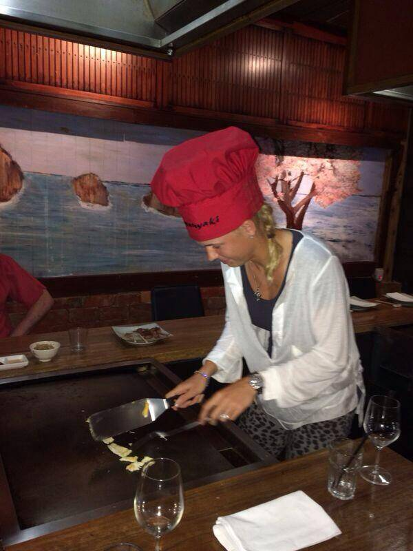 Presenting chef Caroline Wozniacki.  After exhibiting her skills on the court, Wozniacki tosses some ingredients at Japanese tappanyaki (Twitter)