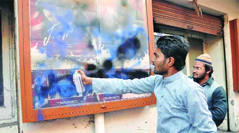 NSUI members distort a poster of Jai Ho. Javed Raja