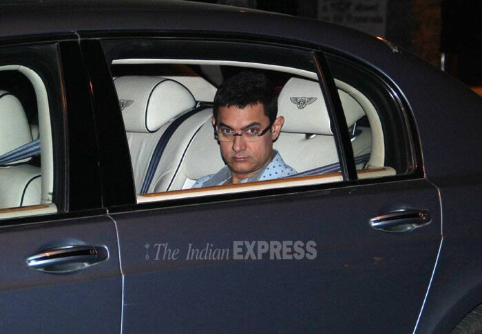Bollywood's Mr Perfectionist Aamir Khan was spotted in his car sporting a geek look. The 'Dhoom: 3' actor is nowadays promoting his close friend Salman Khan's upcoming film 'Jai Ho', which will release o January 24. (Photo: Varinder Chawla)