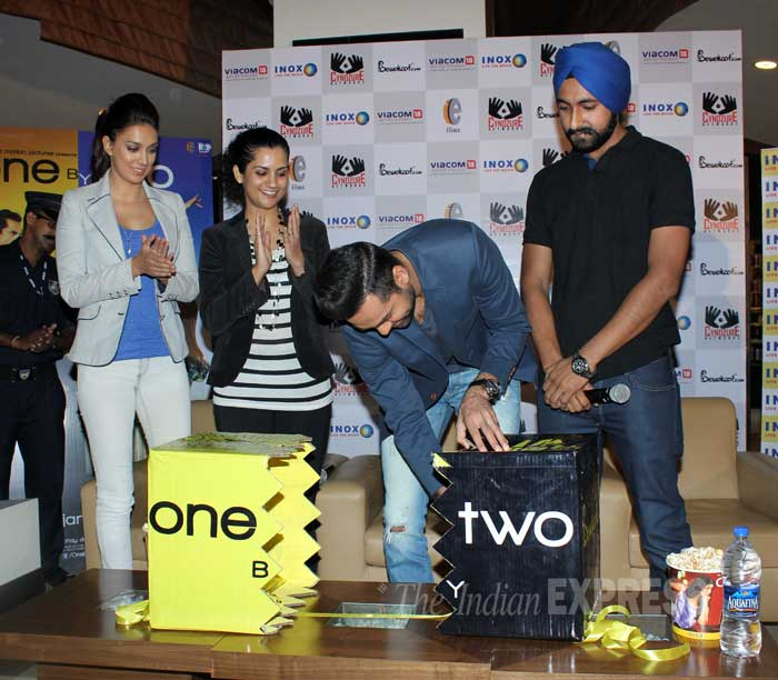 Abhay Deol does the honours, while Preeti and Devika clap politely. (Photo: Varinder Chawla)