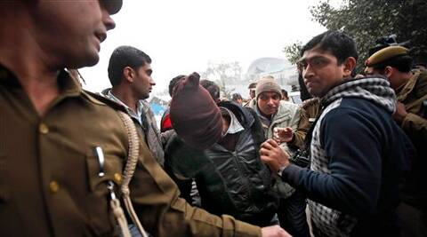 Police officials escort an accused in the gang rape of a 51-year-old Danish tourist to produce him in court in New Delhi. (AP)