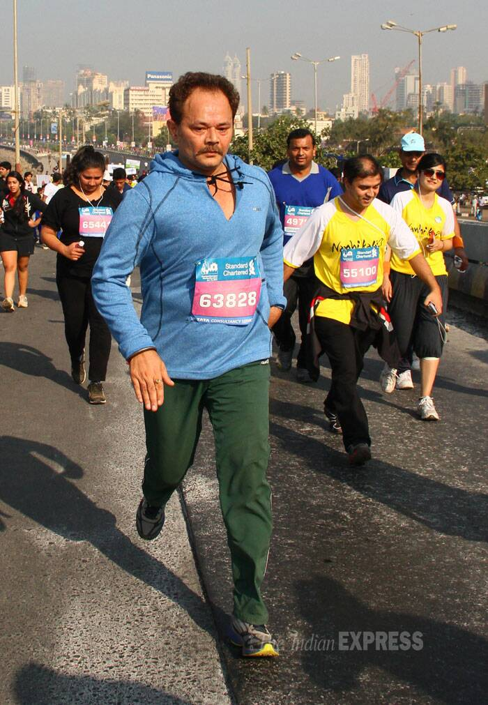 Actor Rajendranath Zutshi runs in the Mumbai Marathon. (IE Photo: Amit Chakravarty).