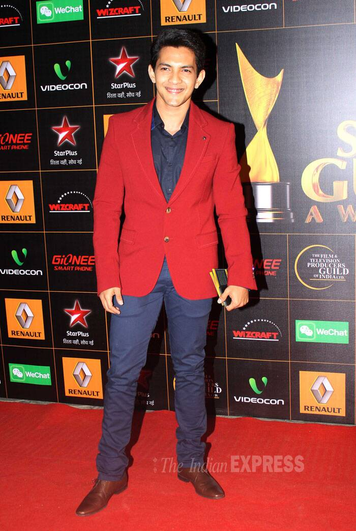 Aditya Narayan, who was nominated for his song 'Tattad Tattad', wore a red suit for the red carpet. (Photo: Varinder Chawla)