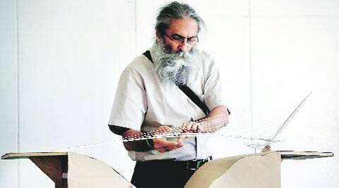 Gurdev Singh of Navrachna University has designed the harp-shaped bridge for Kamatibaug garden.  (IE Photo: Bhupendra Rana)