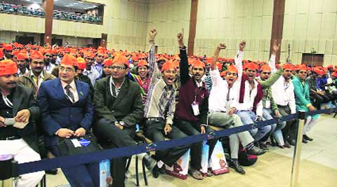 Foreign students at the National Education Summit wear saffron caps distributed at the closing ceremony at Mahatama Mandir in Gandhinagar on Saturday. Express