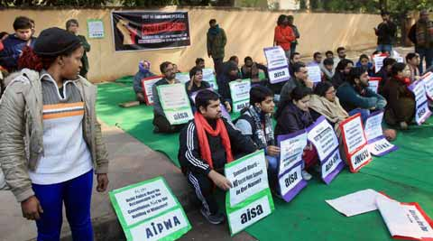 Members of AIPWA, AISA and JNUSU protest against Somnath Bharti on Sunday. (PTI)