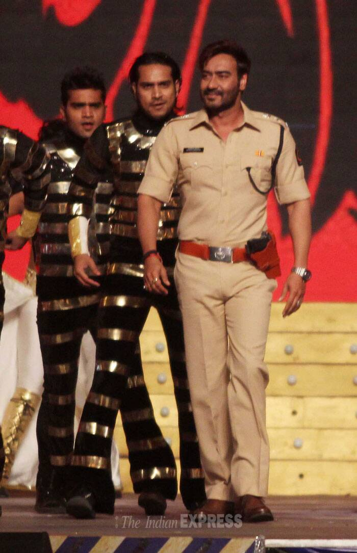 Actor Ajay Devgn dressed in a police uniform performs for Mumbai Police. (Photo: Varinder Chawla)
