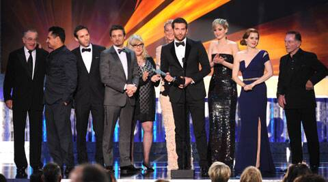 The 20th Annual Screen Actors Guild Awards gave David O Russell's con-man comedy 'American Hustle' the top prize, making it the front-runner for Oscar gold.