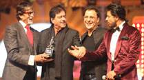 Amitabh Bachchan receives Lifetime Achievement Award from Shatrughan Sinha and Vidhu Vinod Chopra at the Kamla Pasand 20th Annual Life OK Screen Awards in Mumbai. (IE Photo: Prashant Nadkar)