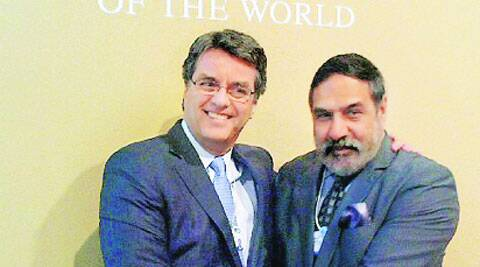 Commerce Minister Anand Sharma with the Director General of WTO Roberto Azevedo in Davos. (Photo: PTI)
