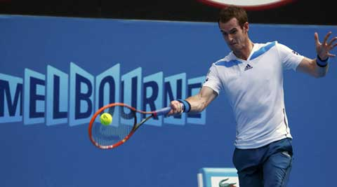 Andy Murray of Britain hits a return to Go Soeda of Japan during their men's singles match at the Australian Open 2014 (Reuters)