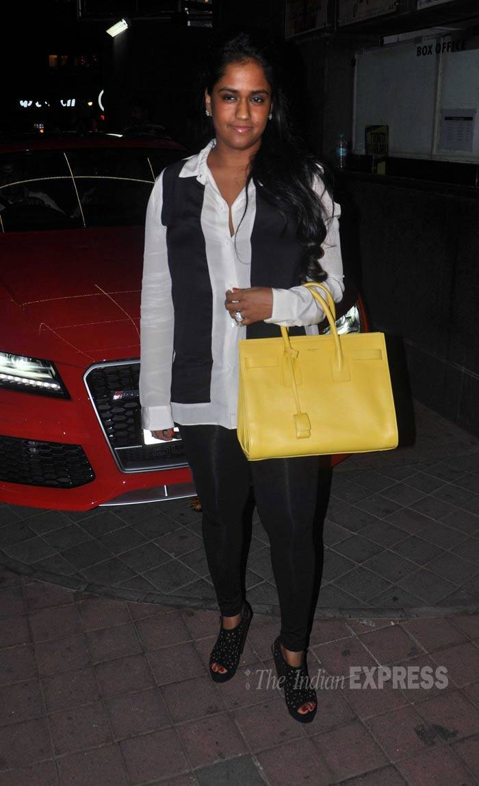 Salman Khan's younger sister Arpita wore a monochrome outfit paired with a bright yellow handbag. (Photo: Varinder Chawla)