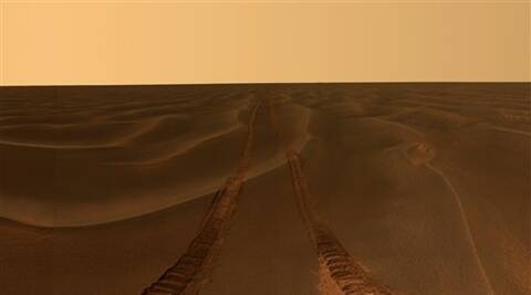This image provided by NASA, shows rover tracks disappearing toward the horizon in a sea of sand between the craters Endurance and Victoria on the Meridiani Plains.