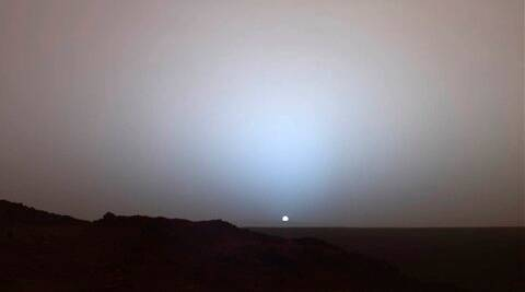 This image provided by NASA shows a view by the Mars Rover Spirit of a sunset over the rim of Gusev Crater, about 80 kilometers (50 miles) away.