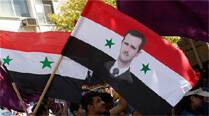US and western European countries are pushing for a transitional government with full executionary powers that would sideline Assad at least for the time being (Reuters)