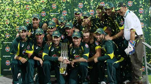 The Australian team members celebrate winning the series during their One Day International cricket match against England in Adelaide (AP)
