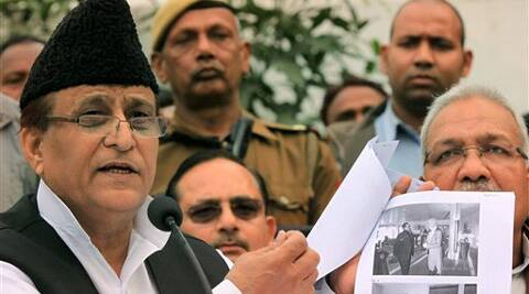 Uttar Pradesh minister Mohd Azam Khan showing pictures of his foreign visit at his residence in Lucknow. (PTI)