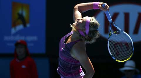 Victoria Azarenka of Belarus serves to Johanna Larsson of Sweden during their women's singles match at the Australian Open 2014 (Reuters)