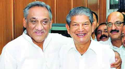Bahuguna and Rawat: The Union minister has told the party he should be rewarded for loyalty