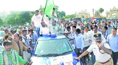 H D Kumaraswamy flags off a bike rally of JD(S) youth members at Kote Anjaneyaswamy Temple in Mysore Wednesday.
