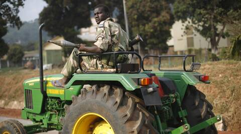 A Seleka Muslim militiaman holding a RPG drives a tractor through Bangui, Central African Republic, Monday Jan. 27, 2014, after evacuating  the Camp de Roux downtown  to relocate and join other Selekas at the PK11 camp. The clearing out of Camp de Roux — normally the army's main base in the capital — comes more than two weeks after rebel leader-turned-president Djotodia surrendered power amid mounting international condemnation of his inability to stop sectarian bloodshed. A new interim civilian government has pledged to halt the violence and attempt to organize elections no later than February 2015. (AP Photo/Jerome Delay