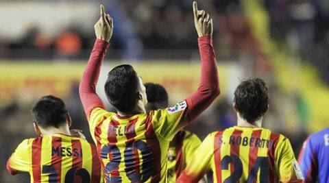 Barcelona's Cristian Tello (C) celebrates with teammates after he scored against Levante during their Spanish King's Cup quarter-final first leg soccer match (Reuters)