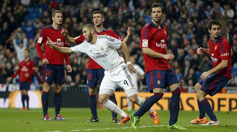 Real Madrid's Karim Benzema from France, centre, celebrates his goal during a match between Real Madrid and Osasuna (AP)