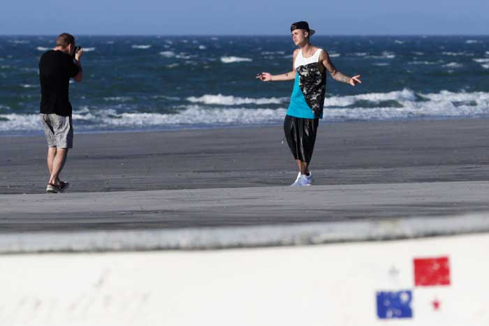 Pop star Justin Bieber is relaxing at the beach in Panama after being charged in Florida with driving under the influence. <br /><br /> Seen here, the disturbed star poses for a picture as he takes a walk on the beach. (AP)