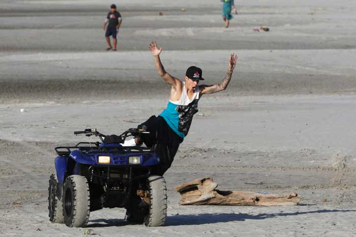Justin Bieber's beach ride seems to have taken a turn as he dramatically falls into the sand. The teen singer was arrested for racing in Lamborghini, while being under the influence of alcohol.<br /><br /> Panamanian radio and television host Eddy Vasquez was filming a show at the Pacific Coast resort in Punta Chame when he spotted Bieber and his entourage walking on the beach. He and his crew took pictures of the singer and his companions, who got on personal watercraft and traveled to a nearby island.   (AP)