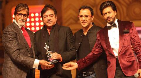 Amitabh Bachchan was presented with the Award by his long-time contemporaries and close friends from the film fraternity, actor Shatrughan Sinha and filmmaker Vidhu Vinod Chopra.