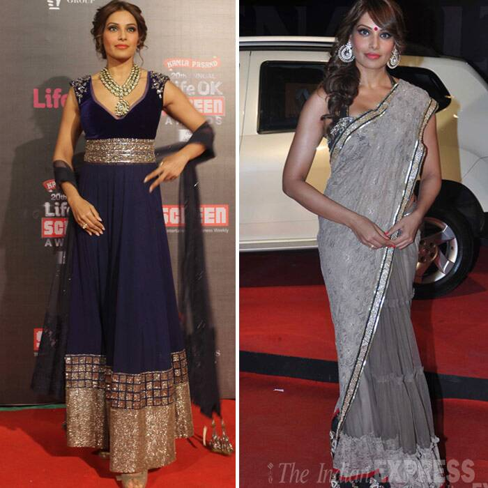 <b>Bipasha Basu</b>: Bengali beauty Bipasha Basu decided to go the traditional route in a midnight blue floor-length anarkali by Manish Malhotra. The actress had her hair styled in a pin-up and donned a signature necklace. <br />The bengali beauty went desi for the second time on red carpet this year. After wearing a Manish Malhotra anarkali for Screen Awards 2014, she was shining in a double shade Binal Shah sari with a big red bindi that did enhance her look! (Photo: Varinder Chawla)