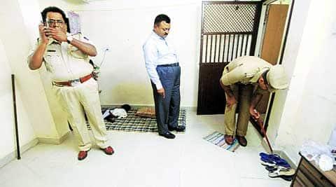 Police at the crime scene on Monday. IE: Narendra Vaskar