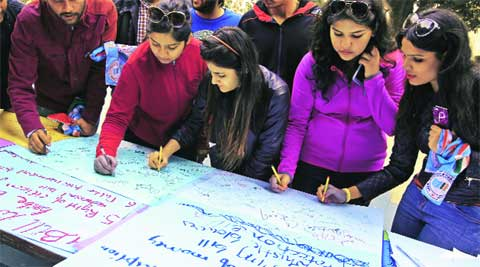 Students take part in a signature campaign organised by NSUI at PU on Wednesday.(IE photo: Sumit Malhotra)