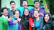 City toppers celebrate after results were declared Tuesday, in Chandigarh. (IE Photo: Sumit Malhotra)