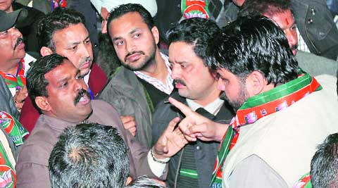 Narenda Chaudhary (left) argues with party workers at the BJP office in Sector 37, Chandigarh, on Wednesday.  (IE photo: Sumit Malhotra)