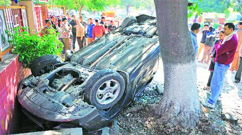 The car turned turtle in front of the Sector 27 Jain Temple on Sunday. Express