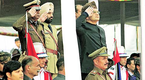 UT Adviser K K Sharma salutes the national flag after unfurling it, at Parade Ground in Sector 17, Chandigarh, Sunday