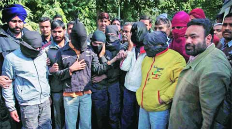 Police parade the eight accused arrested in connection with the dacoity. express archives