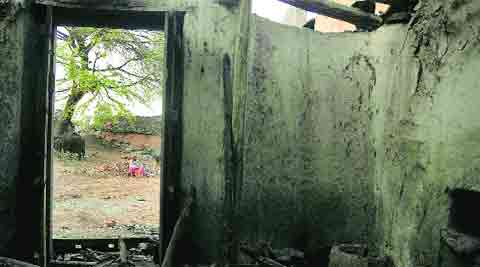 One of the houses that was burnt at Kotadi on Thursday. (Photo: IE)