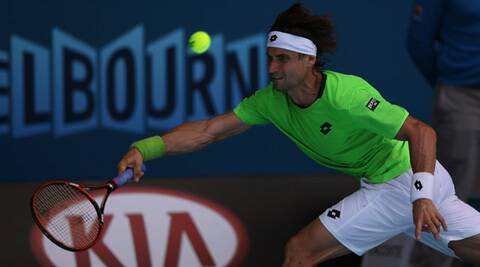 David Ferrer of Spain reaches for a shot  to Jeremy Chardy of France  during their third round match at the Australian Open 2014 (AP)
