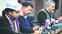 Rakhi Birla and Somnath Bharti flank Kejriwal at a press conference after the raids. 		Archive