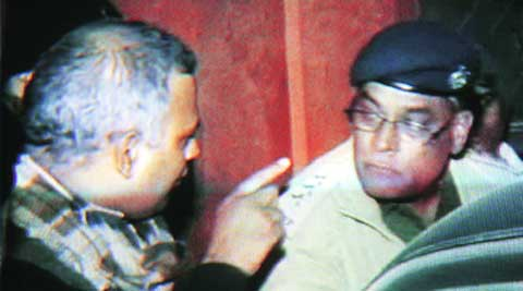 A TV grab of Bharti arguing with a police officer.